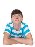 Teenager boy imagines. A teen boy is resting on the floor and imagines royalty free stock image