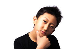 Teenager. Boy isolated on a white background with very intelligent adults look Stock Photo