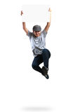Teenager boy jumping and holding blank paper Royalty Free Stock Images