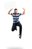 Teenager boy jumping and holding blank paper Stock Photo