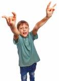 Teenager boy kid shows gesture hands metal rock Stock Images
