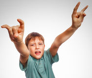 Teenager boy kid shows gesture hands metal rock Royalty Free Stock Photos