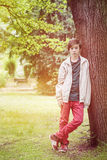 Teenager boy leaning Royalty Free Stock Image