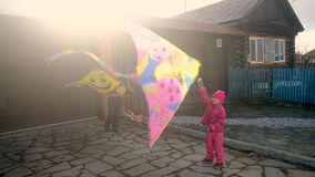 Teenager boy and little girl with a kite in the country.