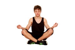 Teenager boy meditating and relaxing after a workout. Stock Photography