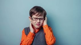 Teenager boy migraine headache holding his head stock video footage