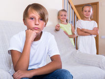 Teenager boy offended on little girlfriends Stock Image