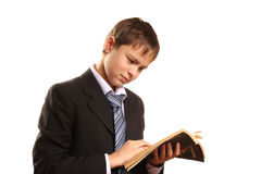 Teenager boy with an open book. On a white background Stock Images