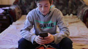 Teenager Boy Playing in Game on Smartphone stock video
