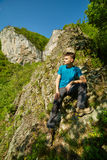 Teenager boy posing on the mountains Stock Photography