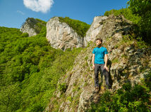 Teenager boy posing on the mountains Stock Images