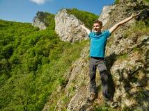 Teenager boy posing on the mountains Stock Photos