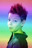Teenager. Boy  with punk  hairstyle  in colorful light Stock Image