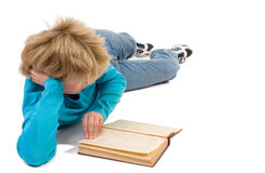 Teenager boy reading ancient book royalty free stock image