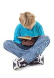 Teenager boy reading a book royalty free stock photography
