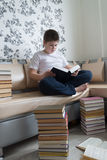 Teenager boy reading a book in room Royalty Free Stock Image