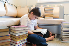Teenager boy reading a book in room Royalty Free Stock Photography
