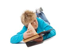 Teenager boy reading old book royalty free stock photography