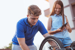 Teenager boy repair tire on bicycle Royalty Free Stock Image