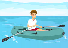 Teenager boy in rubber boat Stock Photo