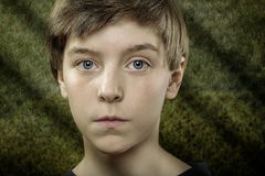Teenager boy with scary green background Royalty Free Stock Photo