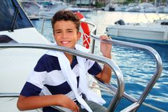 Teenager boy sea marina summer vacation in boat Royalty Free Stock Images