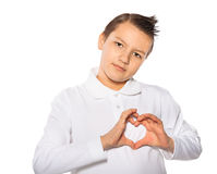 Teenager the boy showing heart shape with hands Royalty Free Stock Photography