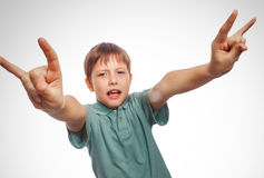 Teenager boy shows gesture hands metal rock devil Royalty Free Stock Photo