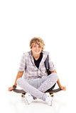 Teenager boy sitting Royalty Free Stock Photos