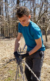 Teenager boy spring cleaning the orchard Royalty Free Stock Photo