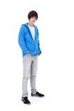 Teenager boy standing. Isolated, studio shot stock image