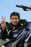 Teenager stood by his motorcycle Stock Photos
