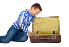 Teenager boy with a suitcase  isolated Stock Photos