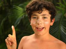Teenager boy with sun screen protection cream close up smiling photo royalty free stock photography
