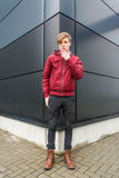Teenager boy thoughtful expression over urban background Stock Photos