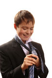 Teenager boy ties a tie on a white background Stock Photos