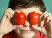 Teenager boy with tomato eyes close up portrait Stock Photo