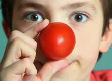 Teenager boy with tomato red nose. Preteen boy with tomato red nose show clown Royalty Free Stock Image