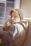 Teenager boy with toque, sitting in a bus Royalty Free Stock Photos