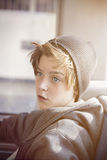 Teenager boy with toque, sitting in a bus Stock Images