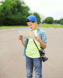 Teenager boy tourist sightseeing city with map. Teenager boy tourist sightseeing city with paper map Stock Photography