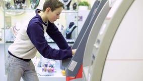 Teenager boy Using Cash Machine stock video