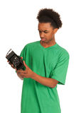 Teenager boy with vintage photo camera. Teenager boy is looking to old vintage photo camera Stock Image