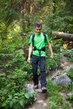 Teenager boy waking through a forest trail Stock Images