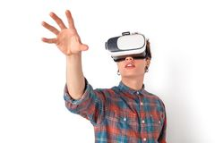 Teenager in virtual reality headset studio standing isolated on white touching empty space close-up. Teenager boy wearing virtual reality headset studio standing royalty free stock photography
