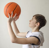 Teenager boy in a white shirt with a ball for basketball Stock Photo