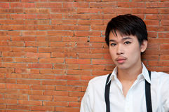 A teenager boy with white shirt and suspenders royalty free stock images