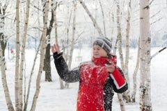 Teenager boy in winter park Stock Image