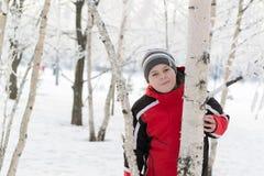 Teenager boy in winter park Stock Photos