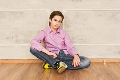 Teenager boy worried sitting on the floor Royalty Free Stock Photography